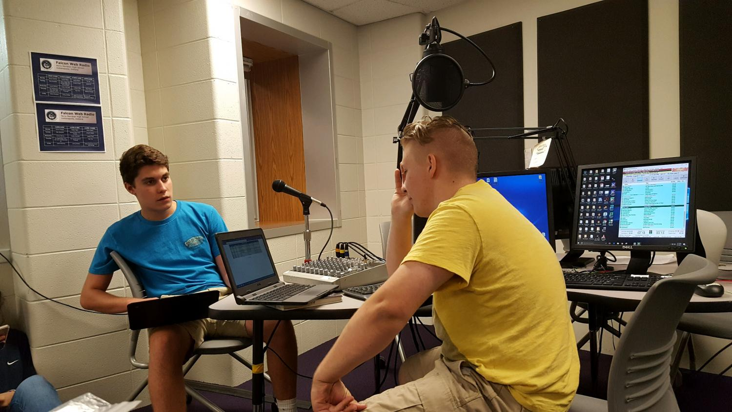 (Left to right) Juniors Cole Stover and Tyler McDonald prep for the upcoming year in Falcon Web Radio sports (Photo by Olivia Lighty).