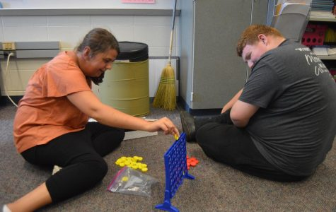 Senior Emily Ray and Kyle Kilgore play Connect Four during their free time in Maggie Cooper's class (Photo by Olivia Lighty).