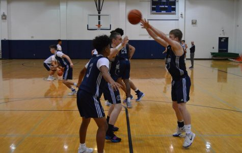 Boys Basketball seniors Adam Taylor,  Gabe Patterson and Reggie McDonald during the team practice on Tuesday.