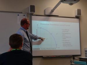 Mr. Tim Dye teaches his economics class about the Production Possibilities Curve (Photo by Ximena Alaniz).