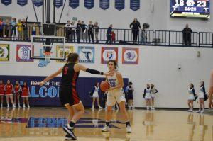 Girls basketball defeats rival Cardinals