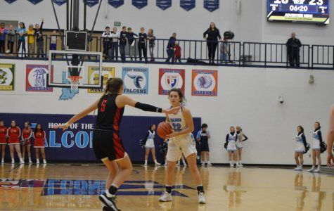 Girls basketball defeats rival Cardinals